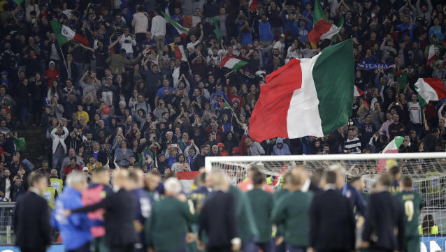 Italian fans wave flags as they celebrate as after their team defeated Greece 2-0 following the end of the Euro 2020 group J qualifying soccer match between Italy and Greece in Rome, Italy, Saturday, Oct. 12, 2019. Italy have qualified for Euro 202 .(AP Photo/Alessandra Tarantino)