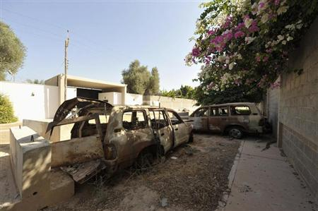 The remnants of cars from attack on U.S. Consulate, which killed U.S. Ambassador Stevens, are seen near wall of consulate in Benghazi
