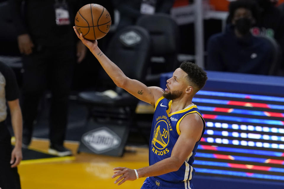 Golden State Warriors guard Stephen Curry (30) shoots against the Cleveland Cavaliers during the second half of an NBA basketball game in San Francisco, Monday, Feb. 15, 2021. (AP Photo/Jeff Chiu)