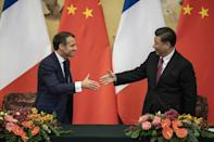 French President Emmanuel Macron and Chinese leader Xi Jinping put on a united front on the Paris climate accord after Washington pulled out