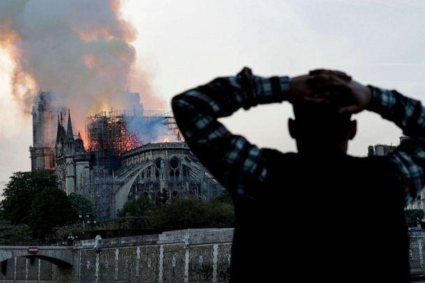 PHOTO: A man watches Notre-Dame Cathedral burn in Paris, April 15, 2019. (Geoffroy Van Der Hasselt/AFP/Getty Images)