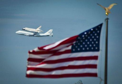 US space shuttle Discovery sitting atop NASA's 747 shuttle carrier aircraft flies over the National Mall in Washington