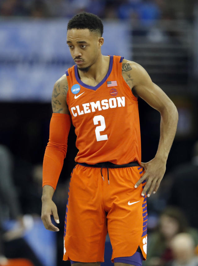 Clemson's Marcquise Reed pauses during the first half of a regional semifinal game against Kansas in the NCAA men's college basketball tournament Friday, March 23, 2018, in Omaha, Neb. (AP Photo/Charlie Neibergall)