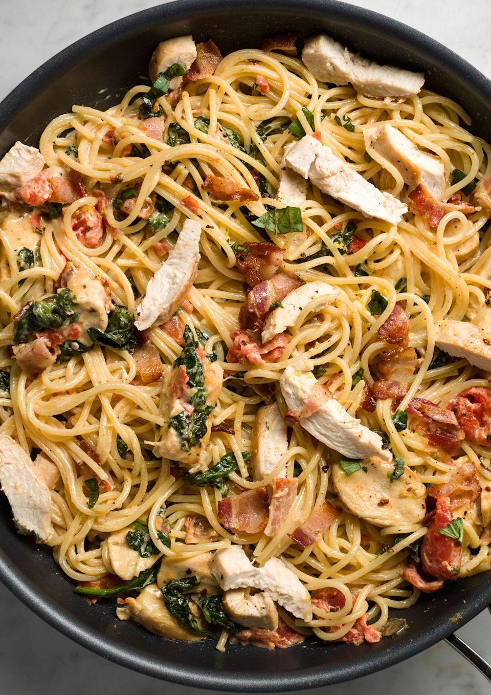 """<p>Loaded with sautéed chicken breasts and crispy bacon, this hearty spaghetti recipe will please even the pickiest eaters.</p><p>Get the from <a href=""""https://www.delish.com/cooking/recipe-ideas/recipes/a45774/chicken-bacon-and-spinach-spaghetti-recipe/"""" rel=""""nofollow noopener"""" target=""""_blank"""" data-ylk=""""slk:Delish"""" class=""""link rapid-noclick-resp"""">Delish</a>. </p>"""
