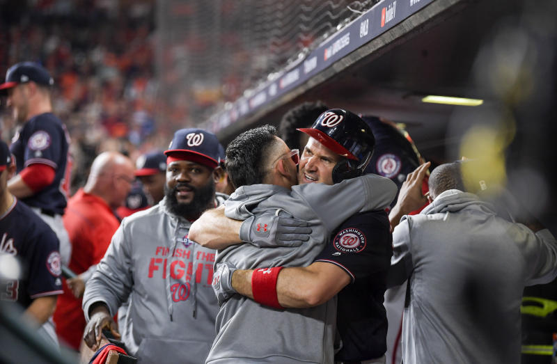 WASHINGTON, DC - OCTOBER 22: Washington Nationals first baseman Ryan Zimmerman (11), right, hugs Washington Nationals center fielder Gerardo Parra (88) after a second inning home run during Game 1 of the World Series between the Washington Nationals and the Houston Astros at Minute Maid Park on Tuesday, October 22, 2019. (Photo by John McDonnell/The Washington Post via Getty Images)