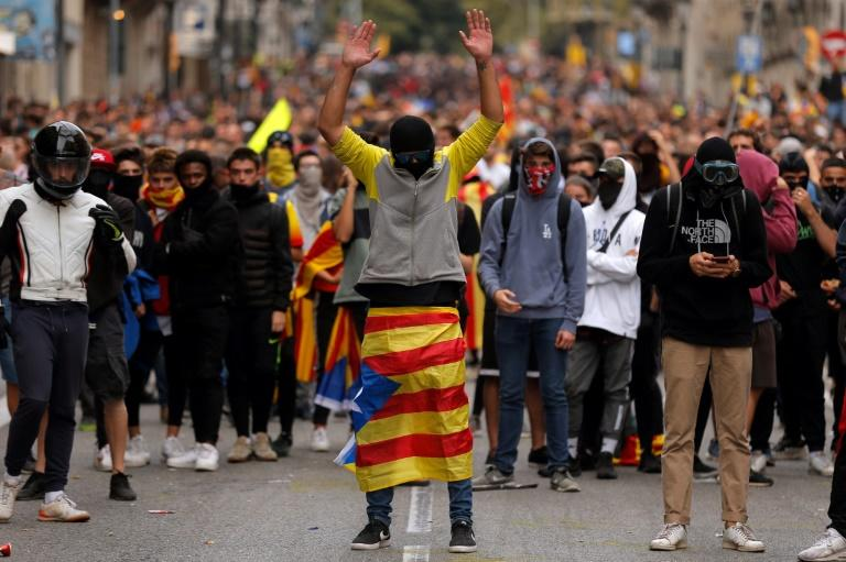 Protesters in Spain have adopted several tactics from Hong Kong, such as wearing masks (AFP Photo/Pau Barrena)