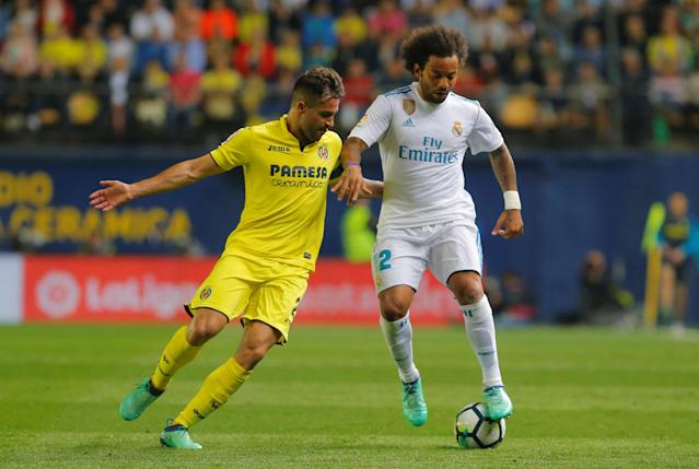 Soccer Football - La Liga Santander - Villarreal vs Real Madrid - Estadio de la Ceramica, Villarreal, Spain - May 19, 2018 Real Madrid's Marcelo in action with Villarreal's Mario Gaspar REUTERS/Heino Kalis