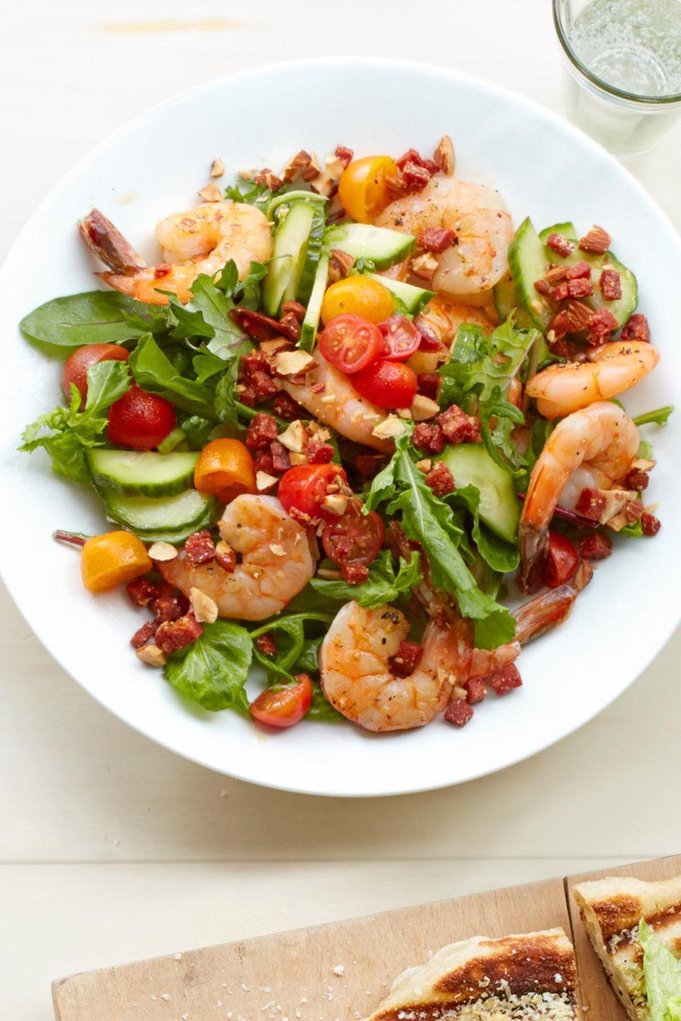 "<p>Crispy bits of chorizo beat out croutons any day.</p><p><a href=""https://www.womansday.com/food-recipes/food-drinks/recipes/a54826/shrimp-salad-with-crispy-chorizo-and-almonds-recipe/"" rel=""nofollow noopener"" target=""_blank"" data-ylk=""slk:Get the recipe for Shrimp Salad with Crispy Chorizo and Almonds."" class=""link rapid-noclick-resp""><em>Get the recipe for Shrimp Salad with Crispy Chorizo and Almonds.</em></a> </p>"