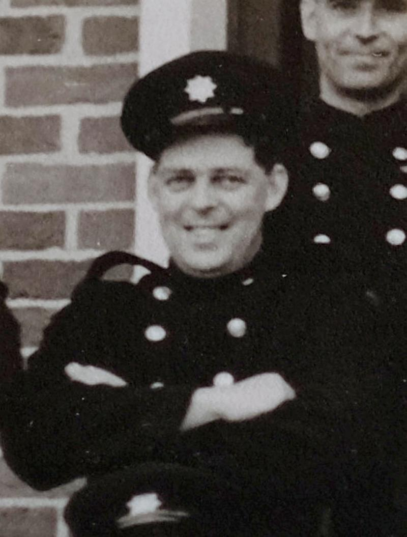John Thompson, pictured when in the Fire Service during the 1950's. A 91-year-old was conned by a fraudster who convincingly posed as a bank branch manager (SWNS)