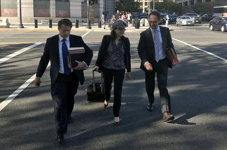 Freeny and Weissmann, members of special counsel Robert Mueller's team of prosecutors leave court in Washington D.C.
