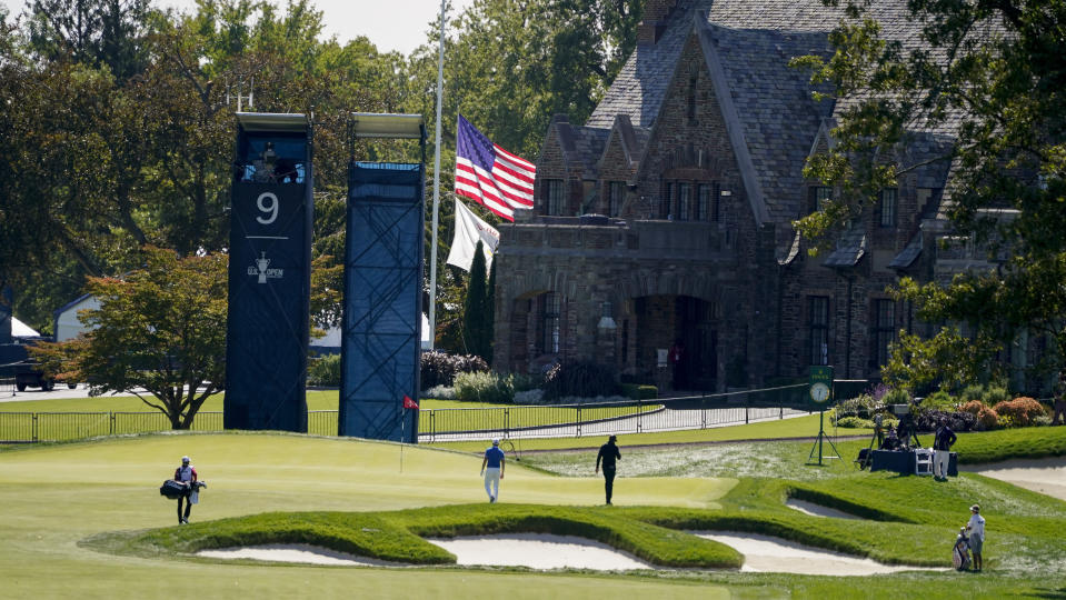 The flag flies at half staff near the ninth green in memory of Supreme Court judge Ruth Bader Ginsburg at Winged Foot Golf Club during the third round of the US Open Golf Championship, Saturday, Sept. 19, 2020, in Mamaroneck, N.Y. Ginsburg died on Friday. (AP Photo/Charles Krupa)