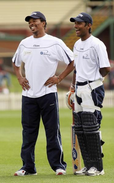 MELBOURNE, AUSTRALIA - SEPTEMBER 30: (L-R) Makhaya Ntini of South Africa and Kumar Sangakkara of Sri Lanka have a laugh during ICC World Xl Squad training at Junction Oval September 30, 2005 in Melbourne, Australia. (Photo by Quinn Rooney/Getty Images)