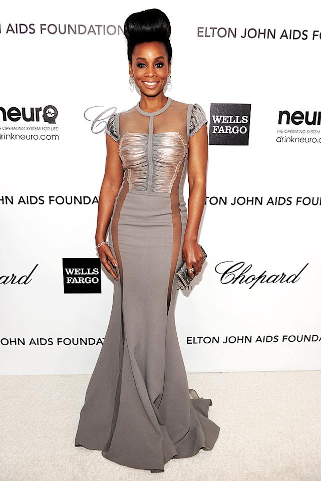 Anika Noni Rose delivered a style no-no upon arriving at Elton John's annual Oscar party in this revealing Basil Soda bomb. The singer/actress is beyond beautiful -- and we're loving her exaggerated bun -- but, showing this much skin at an AIDS fundraiser is a tad tacky.