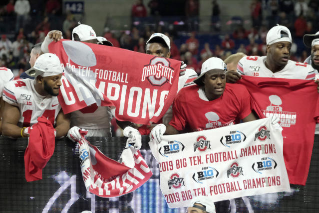 Members of the Ohio State teams celebrate after defeating Wisconsin 34-21 in the Big Ten championship NCAA college football game, Saturday, Dec. 7, 2019, in Indianapolis. (AP Photo/AJ Mast)