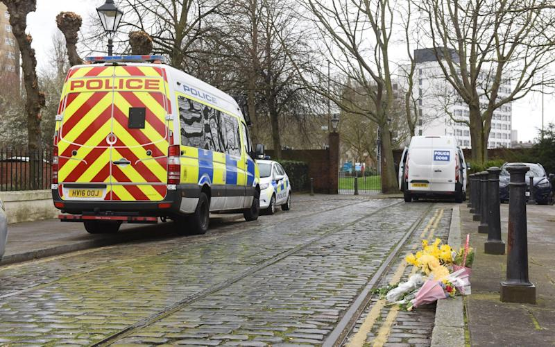Flowers were left at the scene where the baby's body was discovered yesterday morning. - Solent News & Photo Agency