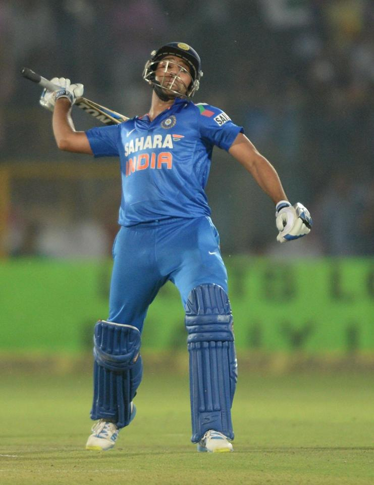 Indian batsman Rohit Sharma celebrates win during the 2nd ODI match between India and Australia being played at Sawai Mansingh Stadium, Jaipur on Oct. 16, 2013. (Photo: IANS)