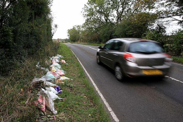 PHOTO: Floral tributes lay on the roadside near RAF Croughton in Northamptonshire, central England, Oct. 10, 2019, at the spot where British motorcyclist Harry Dunn was killed as he traveled along the B4031 on Aug. 27, 2019. (AFP via Getty Images, FILE)
