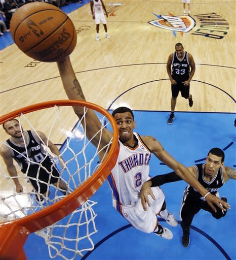 Oklahoma City Thunder shooting guard Thabo Sefolosha (2), of Switzerland, shoots past San Antonio Spurs shooting guard Manu Ginobili (20), of Argentina, and guard Danny Green (4) during the first half of Game 6 in the NBA basketball Western Conference finals, Wednesday, June 6, 2012, in Oklahoma City. (AP Photo/Jim Young, Pool)