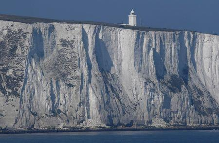 South Foreland lighthouse and the white cliffs of Dover are seen from a cross-channel ferry between Dover in Britain and Calais in France, March 27, 2017.  REUTERS/Toby Melville - RTX32XME