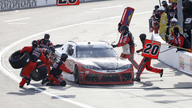 Crew members change tires on Christopher Bell's car during a pit stop in a NASCAR Xfinity Series auto race, Sunday, June 16, 2019, at Iowa Speedway in Newton, Iowa. (AP Photo/Charlie Neibergall)