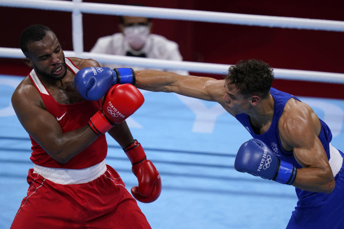 New Zealand's David Nyika, right, lands a punch to Youness Baalla, of Morocco, during their heavy weight (91kg) preliminary boxing match at the 2020 Summer Olympics, Tuesday, July 27, 2021, in Tokyo, Japan. (AP Photo/ Frank Franklin II)