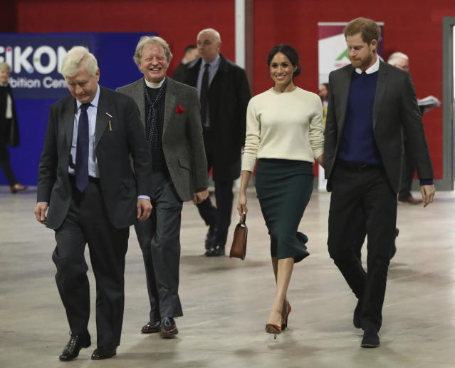 Markle's green skirt made a strong style statement. (Photo: Niall Carson/Pool via AP)