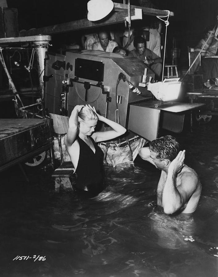 <p>Grace Kelly and Cary Grant film a scene for <em>To Catch a Thief </em>in a studio swimming pool in 1955. </p>