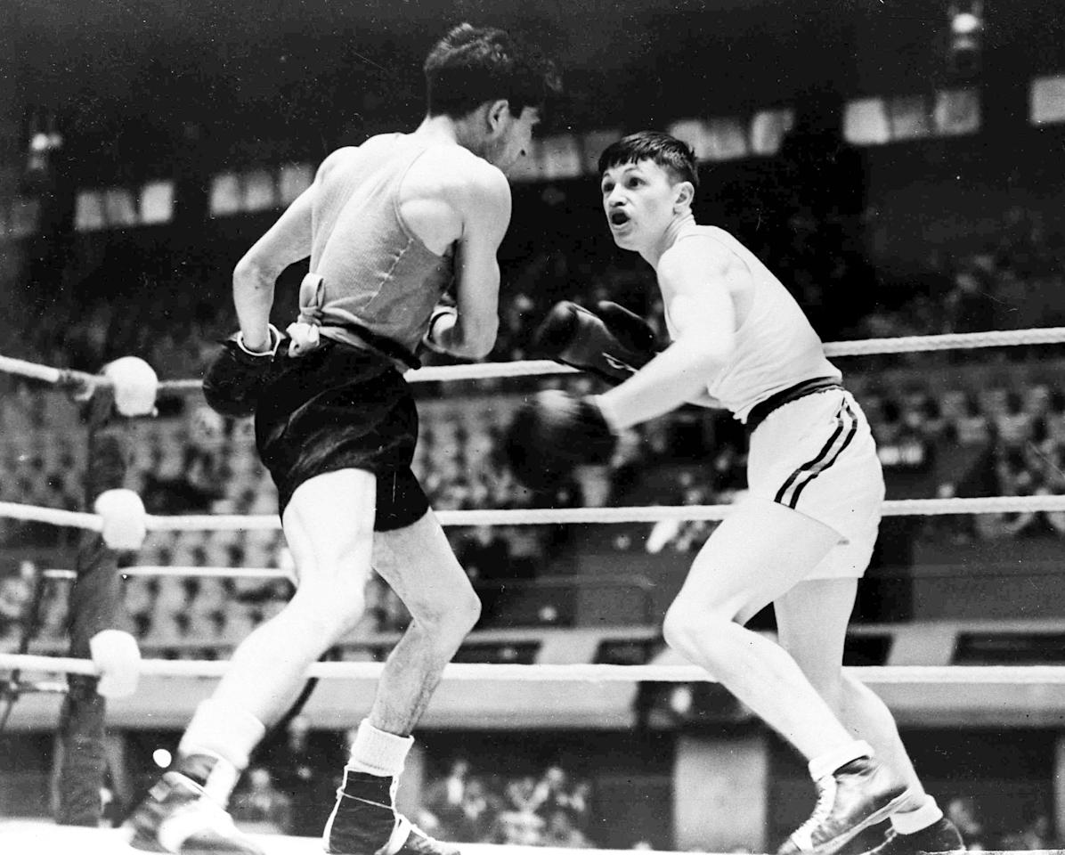 Australia's R. Gower, right, and L. Zapata Martinez of Spain during their men's Olympic Games Flyweight Boxing bout at the Empire Pool, Wembley, London, Aug. 10, 1948. Martinez won the bout on a points decision. (AP Photo)