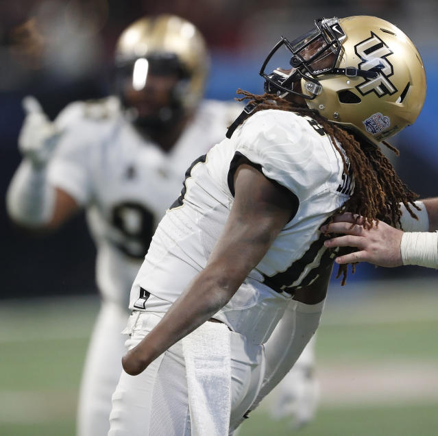 Central Florida linebacker Shaquem Griffin (18) celebrates a sack on Auburn quarterback Jarrett Stidham (8) during the second half of the Peach Bowl NCAA college football game, Monday, Jan. 1, 2018, in Atlanta. (AP)
