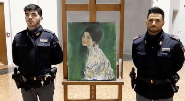 PHOTO: Italian police stand next to what they say is 'Portrait of a Lady' by Austrian artist Gustav Klimt that was stolen in 1997 and was found hidden in an outside wall of an Italian gallery, in Piazcenza, Italy Dec. 10, 2019. (Polizia Di Stato via Reuters)