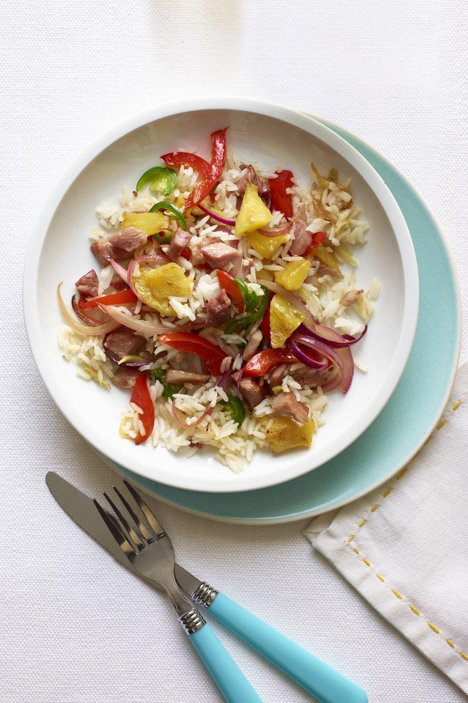 "<p>Pineapple and ham are the unlikeliest pair, but this delicious recipe is packed with 12 g of protein. </p><p><a href=""https://www.womansday.com/food-recipes/food-drinks/recipes/a12369/pineapple-ham-fried-rice-recipe-wdy0414/"" rel=""nofollow noopener"" target=""_blank"" data-ylk=""slk:Get the Pineapple and Ham Fried Rice recipe."" class=""link rapid-noclick-resp""><em><strong>Get the Pineapple and Ham Fried Rice recipe.</strong></em></a></p><p><strong><a class=""link rapid-noclick-resp"" href=""https://www.amazon.com/dp/B00FLYWNYQ/?tag=syn-yahoo-20&ascsubtag=%5Bartid%7C10070.g.2176%5Bsrc%7Cyahoo-us"" rel=""nofollow noopener"" target=""_blank"" data-ylk=""slk:SHOP INSTANT POTS"">SHOP INSTANT POTS</a></strong></p>"