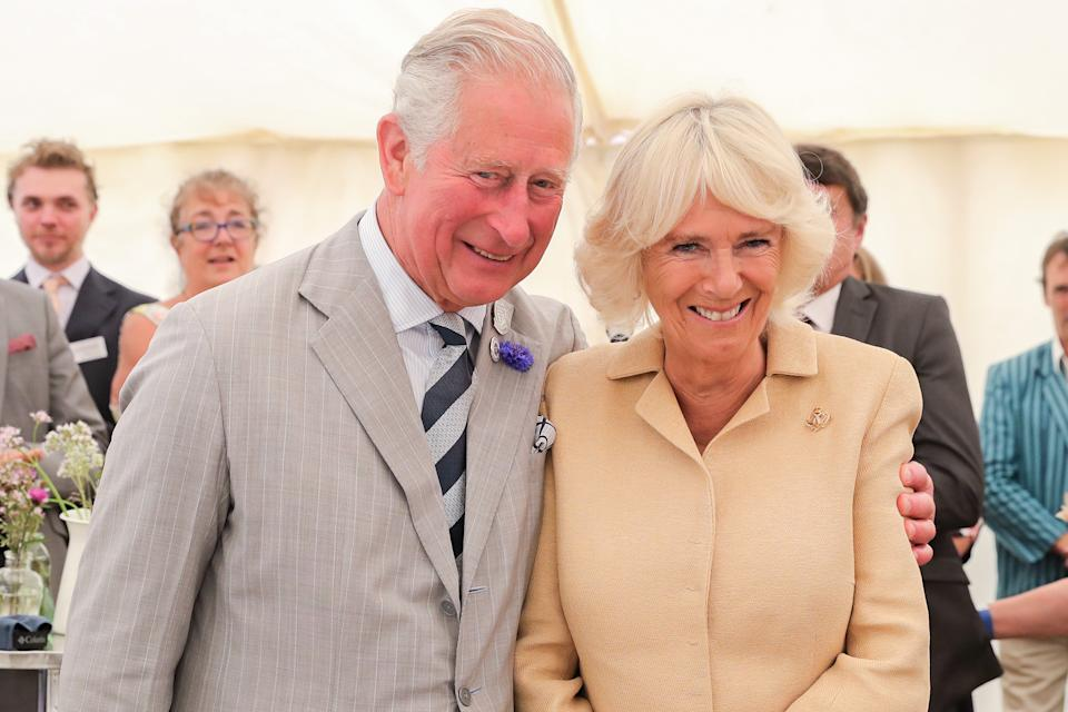SIMONSBATH, ENGLAND - JULY 17: Camilla, Duchess of Cornwall is sung Happy Birthday by Prince Charles, Prince of Wales and the crowds gathered at the National Parks 'Big Picnic' celebration in honour of all 15 of the UK's National Parks, during an official visit to Devon & Cornwall on July 17, 2019 in Simonsbath, England. Held in Exmoor National Park the picnic marks 70 years since they were created by the 1949 National Parks and Access to the Countryside Act. (Photo by Chris Jackson/Getty Images)