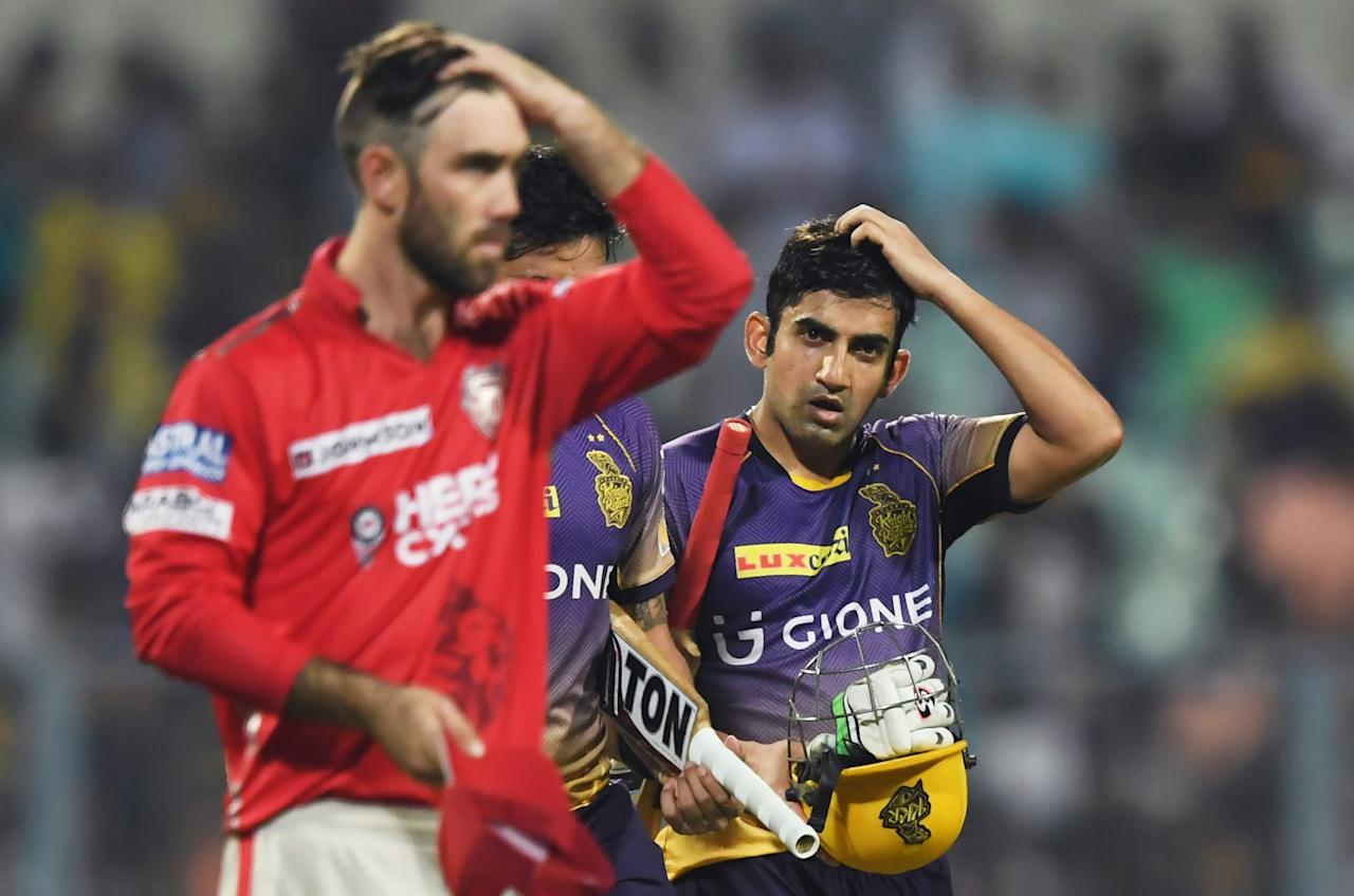 <p>Kolkata Knight Riders captain Gautam Gambhir and Kings XI Punjab cricketer Glenn Maxwell gesture after the 2017 Indian Premier League Twenty20 cricket match between Kolkata Knight Riders and Kings XI Punjab at The Eden Gardens Cricket Stadium in Kolkata on April 13, 2017. </p>