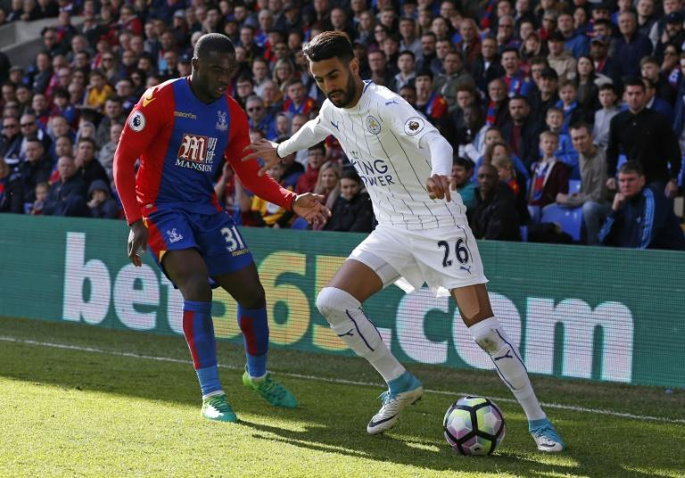 Crystal Palace's Jeffrey Schlupp vies with Leicester City's Riyad Mahrez (R) during their match at Selhurst Park in south London on April 15, 2017