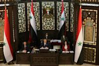 Syrian parliament speaker Hamouda Sabbagh (C) announces that presidential elections in the war-torn country will be held on May 26