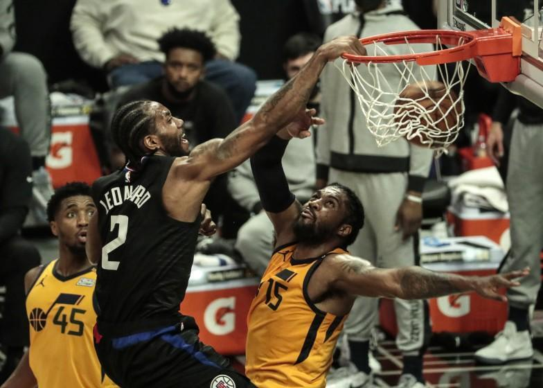 Los Angeles, CA, Monday, June 14, 2021 - LA Clippers forward Kawhi Leonard (2) slam dunks over Utah Jazz center Derrick Favors (15) late in the first half in game four of the NBA Western Conference semifinals at Staples Center (Robert Gauthier/Los Angeles Times)