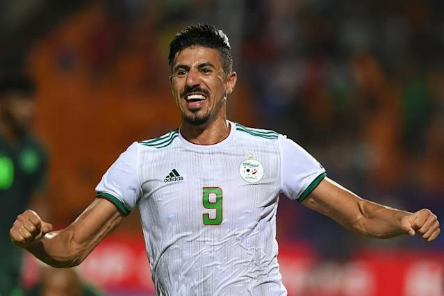 Forward Baghdad Bounedjah celebrates a 2-1 victory over Nigeria that qualified Algeria for the 2019 Africa Cup of Nations final in Cairo (AFP Photo/MOHAMED EL-SHAHED )