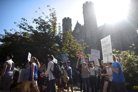 West Chester University students demonstrate with university employees from the union representing 5,500 Pennsylvania university and college employees after failing to reach a contract deal with the state education system in West Chester, Pennsylvania, U.S., October 19, 2016. REUTERS/Mark Makela
