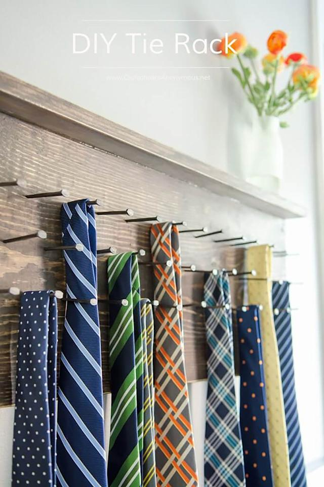 """<p>Help Dad get organized this Father's Day with a DIY tie rack that can hold more than 35 ties.<br></p><p><strong>Get the tutorial at <a rel=""""nofollow"""" href=""""http://www.craftaholicsanonymous.net/diy-tie-rack-tutorial"""">Craftaholics Anonymous</a>. </strong></p><p><strong>What you'll need:</strong> wood stain ($19, <a rel=""""nofollow"""" href=""""https://www.amazon.com/gp/product/B00714LKAC/"""">amazon.com</a>); old-fashioned nails ($6, <a rel=""""nofollow"""" href=""""https://www.amazon.com/gp/product/B000FPCGAW/"""">amazon.com</a>); brad nailer ($100, <a rel=""""nofollow"""" href=""""https://www.amazon.com/gp/product/B07BK9SV2V/"""">amazon.com)</a></p>"""