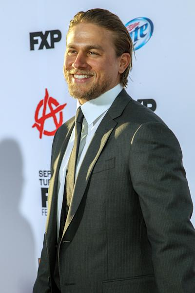 """Actor Charlie Hunnam arrives at the season 6 premiere screening of """"Sons of Anarchy"""" at the Dolby Theatre on Saturday, Sept. 7, 2013 in Los Angeles. (Photo by Paul A. Hebert/Invision/AP)"""