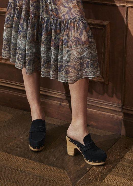 <p>Hear that? It's the sound of these wooden-soled clogs stepping up as fall's biggest footwear trend. </p><p><em>Veronica Beard</em></p>