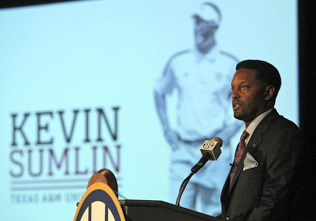 Texas A&M coach Kevin Sumlin speaks to the media at the Southeastern Conference NCAA college football media days, Tuesday, July 15, 2014, in Hoover, Ala. (AP Photo/Butch Dill)