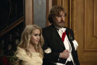 """This image released by Amazon Studios shows Maria Bakalova, left, and Sacha Baron Cohen in a scene from """"Borat Subsequent Moviefilm."""" The film was nominated for a Golden Globe for best musical/comedy.(Amazon Studios via AP)"""