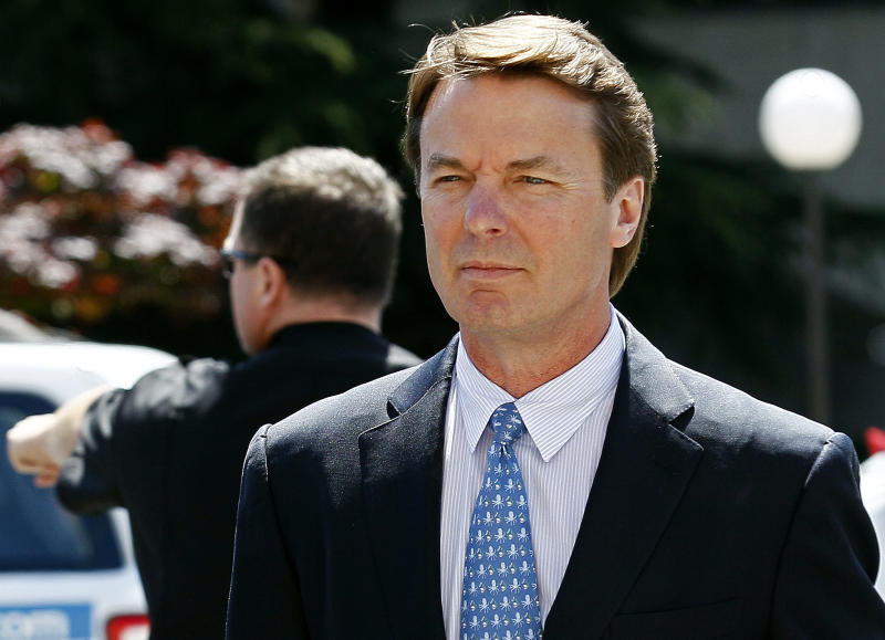 FILE - In this April 12, 2012, file photo, former presidential candidate and U.S. Sen. John Edwards arrives outside federal court following a lunch break in jury selection for his criminal trial on alleged campaign finance violations in Greensboro, N.C. Prosecutors accuse Edwards of using campaign money from wealthy donors to hide his pregnant mistress, Rielle Hunter. Andrew Young, a former aide to Edwards, testified for five days last week. He said Edwards knew the money was being spent to hide Hunter, but also acknowledged that he used much of the funds to build his North Carolina dream house. (AP Photo/Gerry Broome, File)