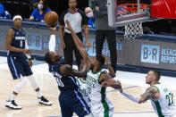 Dallas Mavericks forward Dorian Finney-Smith (10) shoots as Boston Celtics forward Tristan Thompson (13) defends during the second half of an NBA basketball game in Dallas, Tuesday, Feb. 23, 2021. (AP Photo/Sam Hodde)