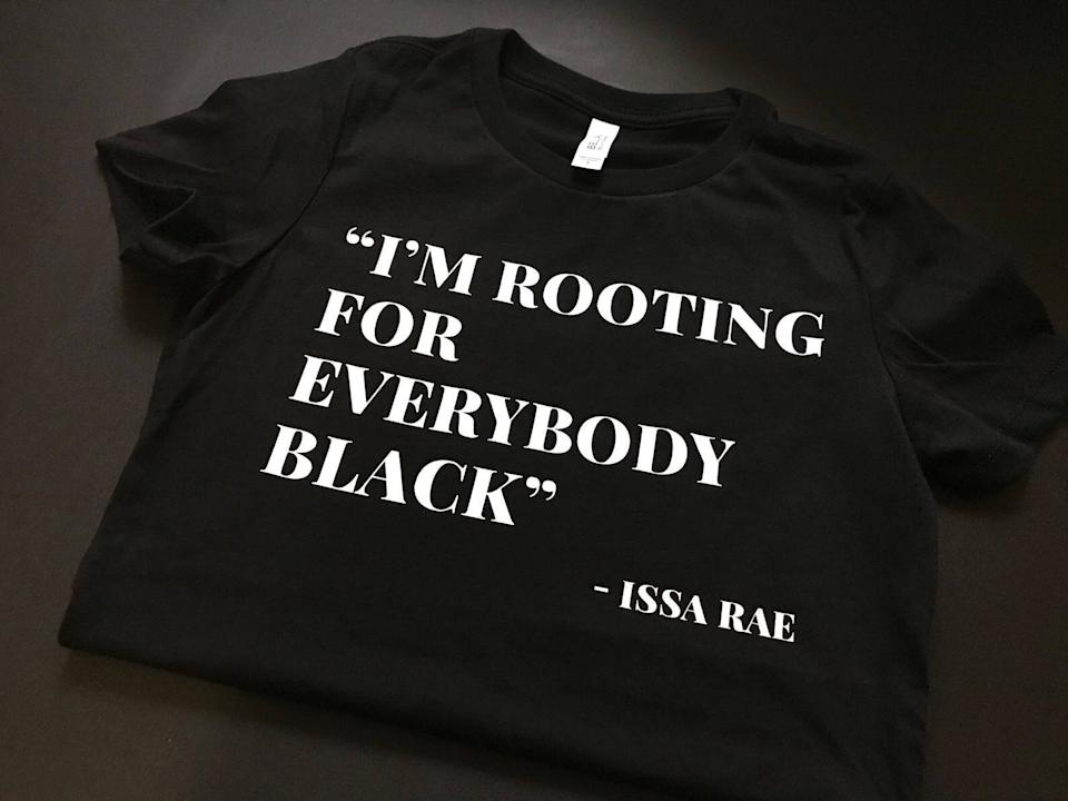 """Get the <a href=""""https://knowdefinition.com/product/im-rooting-for-everybody-black-t-shirt/"""" target=""""_blank"""" rel=""""noopener noreferrer"""">""""I'm Rooting For Everybody Black"""" T-shirt from Know Definition for $30</a>"""