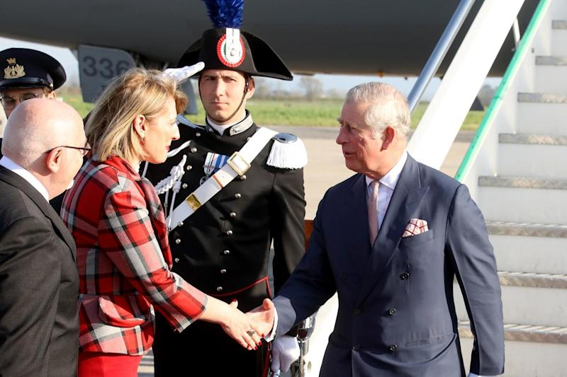 Prince Charles greeted by Karen Bradley MP, the UK culture secretary at Pisa Airport: Getty Images