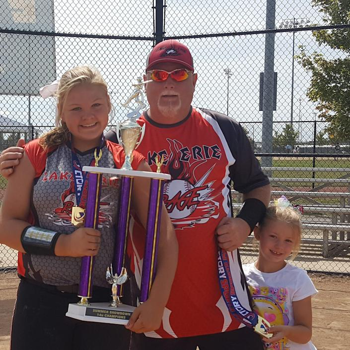 Lewis Dunlap coached Mallory's travel softball team for eight years. Younger daughter Camille also plays.
