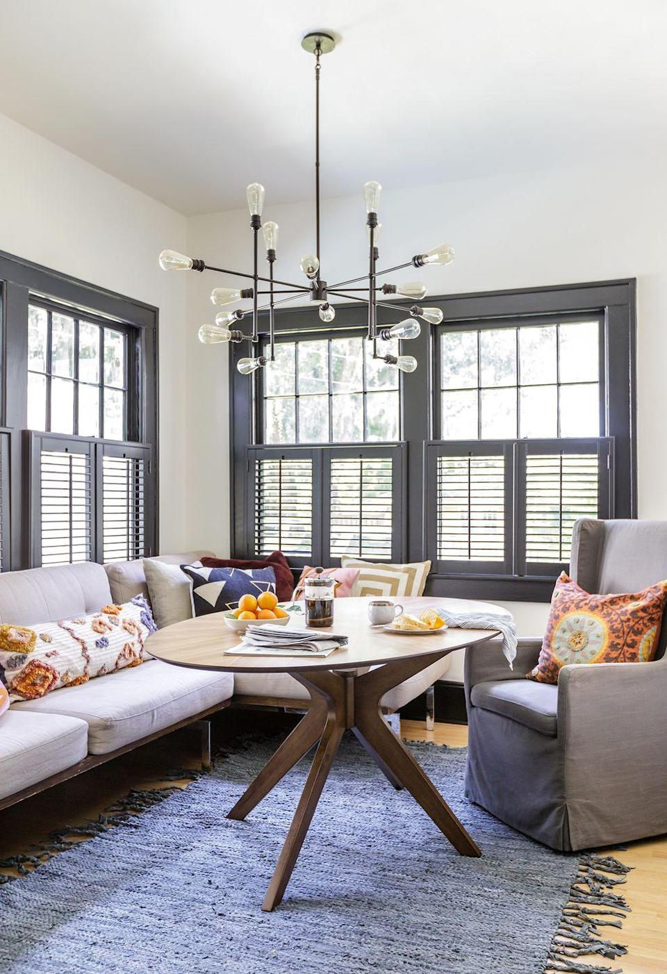 """<p>How could you possibly not have a good morning in this sun-drenched breakfast nook? Designer and occupant <a href=""""https://www.fitzpullins.com/"""" rel=""""nofollow noopener"""" target=""""_blank"""" data-ylk=""""slk:Fitz Pullins"""" class=""""link rapid-noclick-resp"""">Fitz Pullins</a> removed the French doors connecting the kitchen to this bonus space, enhancing flow and sunlight the bright yet neutral and calming colors along with the laidback materials that reflects the his own own warmth as well as the Florida landscape. And the best part? No building necessary—the banquette seating here is just the right-sized sofa. </p>"""