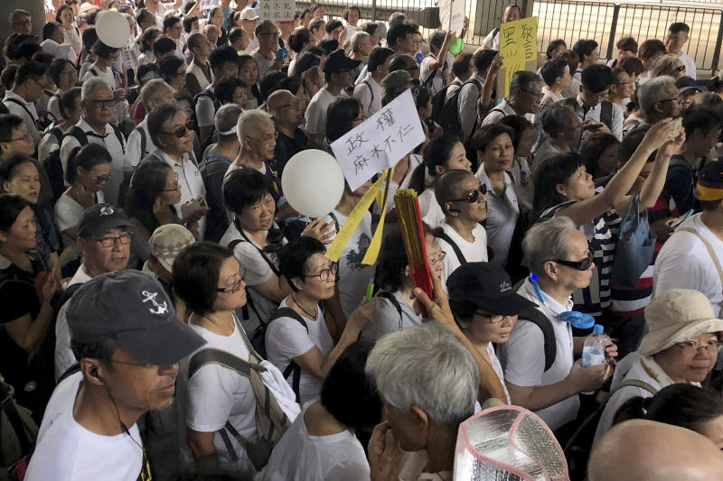 Elderly Hong Kong residents march in Hong Kong on Wednesday, July 17, 2019. Some 2,000 Hong Kong senior citizens, including a popular actress, marched Wednesday in a show of support for youths at the forefront of monthlong protests against a contentious extradition bill in the semi-autonomous Chinese territory.(AP Photo/Phoebe Lai)